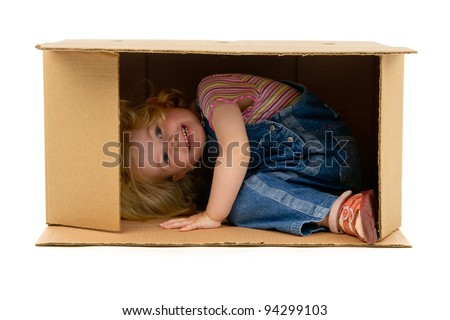 little girl inside a Box on a white background - stock photo