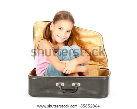 little girl inside a suitcase