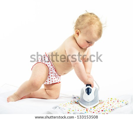 Little girl  ironing on the floor, isolated