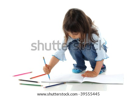 Little girl is drawing on white paper in album isolated - stock photo