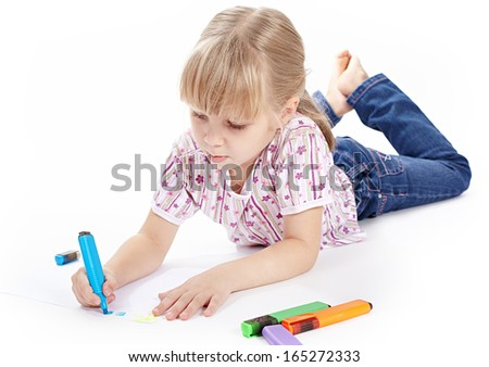 Little girl is drawing with colored markers