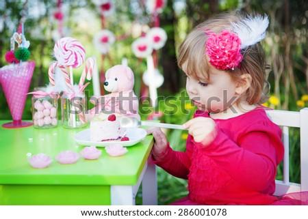 little girl is eating cake - stock photo