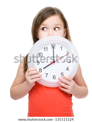 Little girl is holding big clock, isolated over white - stock photo