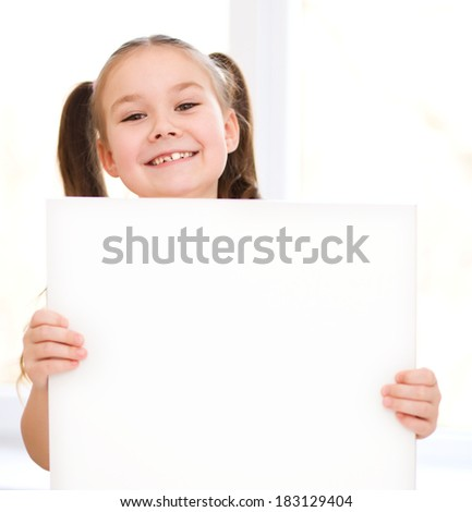 Little girl is holding blank banner - stock photo
