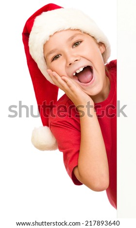 Little girl is holding her face in astonishment standing near blank board, isolated over white - stock photo