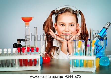 Little girl is making science experiments. Education. - stock photo