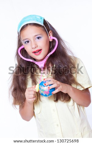 little girl is playing doctor - stock photo