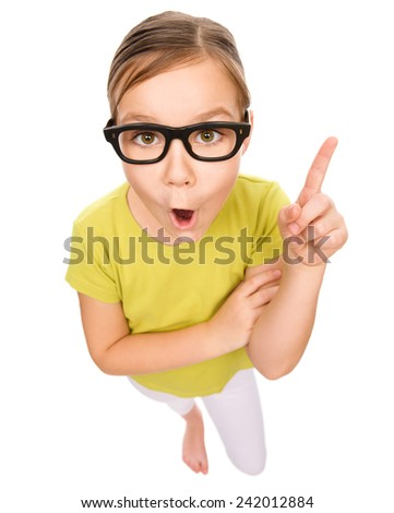 Little girl is pointing up using her index finger, idea concept, fisheye portrait, isolated over white - stock photo