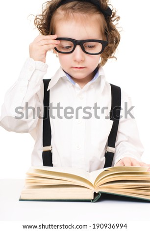 little girl is reading a book, isolated over white - stock photo