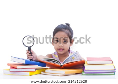 Little girl is reading book and showing magnifier.