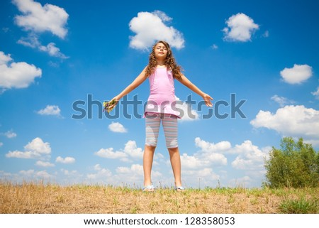 little girl is relaxing in nature