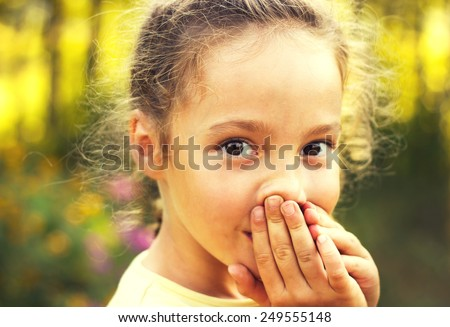 Little girl is shocked and surprised and so happy about it. Toned - stock photo