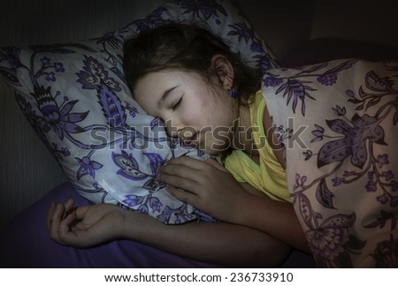 Little girl is sleeping well in her bed. Toned photo - stock photo