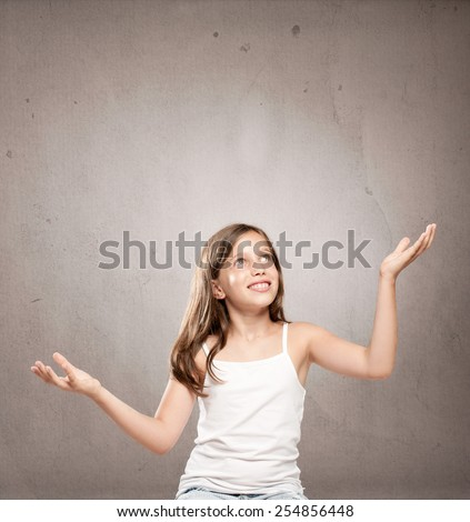 little girl juggling with copy space - stock photo