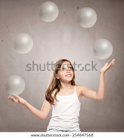 little girl juggling with crystal sphere balls - stock photo