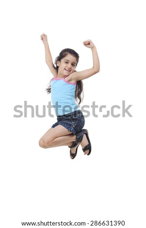 Little girl jumping in the air - stock photo