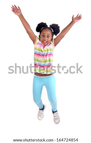 little girl jumping isolated in white
