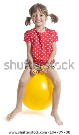 little girl jumping on ball - isolated