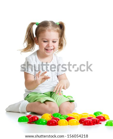 little girl kid playing with  mosaic toy - stock photo
