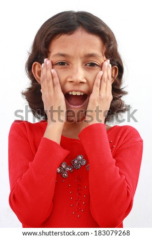 Little girl kid surprised with hands on her face - stock photo