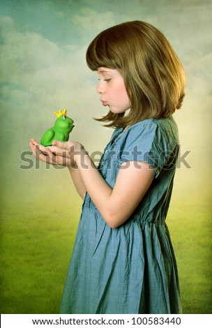 Little girl kissing a frog prince - stock photo