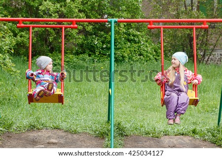 Little girl laughing in the Playground