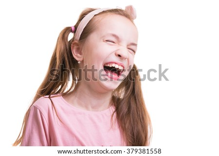 Little girl laughing. Shriek with laughter. Girl screw up her eyes (narrow her eye) with laughter. - stock photo