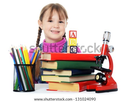 Little girl learn isolated on white background - stock photo