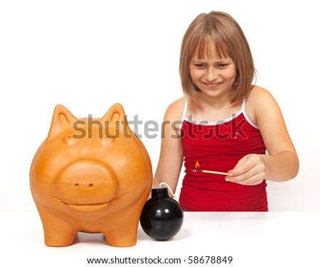 Little girl lighting a bomb to explode the piggy bank - stock photo