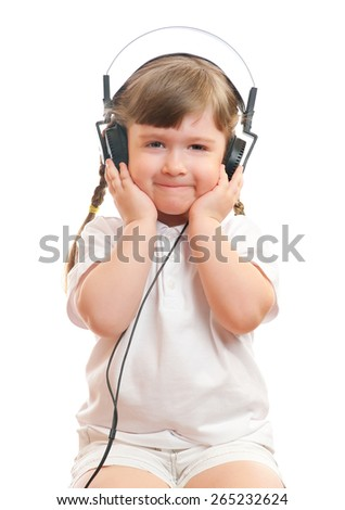 Little girl listen music by ear-phones - stock photo