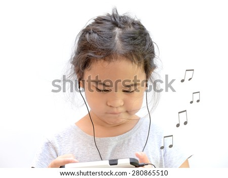 Little girl listen music with song note blowing - stock photo