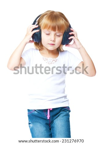 Little girl listening to music on headphones.Isolated on white background. - stock photo