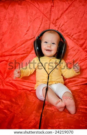 Little girl listens the music