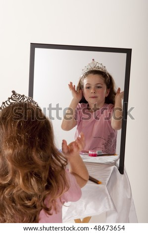 Little Girl Looking Herself Mirror While Stock Photo
