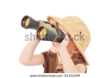 Little girl looking into binoculars - stock photo
