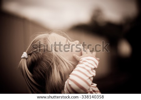 Little girl looking intrigued - stock photo