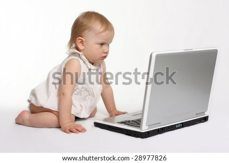 little girl looking on the laptop