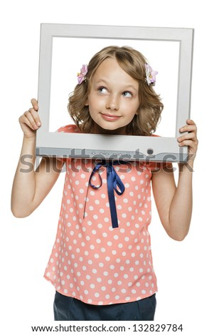 Little girl looking through the TV / computer screen frame, over white background - stock photo