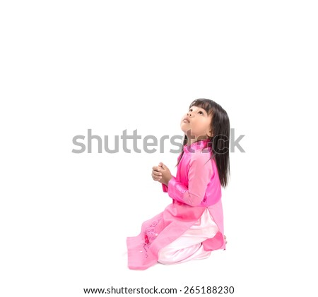 little girl looking up and praying gratefully isolated - stock photo