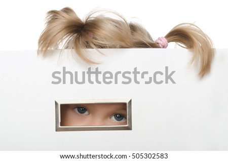 little girl looks inquisitively out of box isolated on white