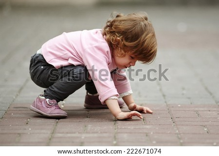 little girl lying on asphalt portrait