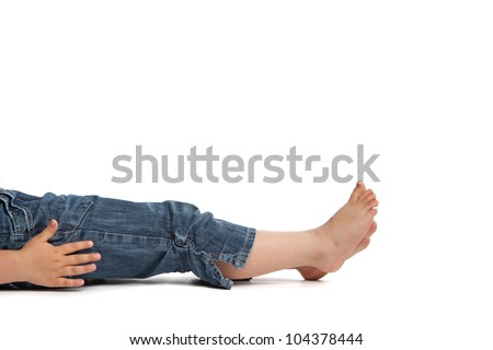 little girl lying on back in front of a white background