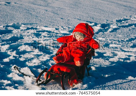 little girl lying on snow