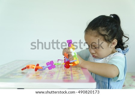 Little girl made toy blocks,Attention Deficit Hyperactivity Disorder,ADHD child activity therapy at home