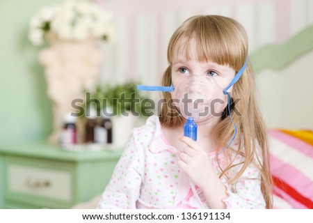 little girl makes inhalation home - stock photo