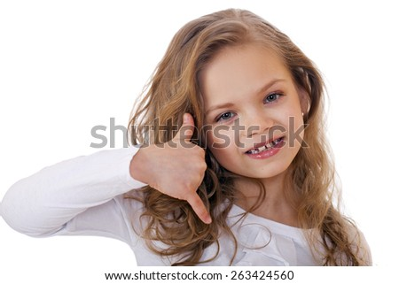 Little Girl making a call me gesture, against white background  - stock photo