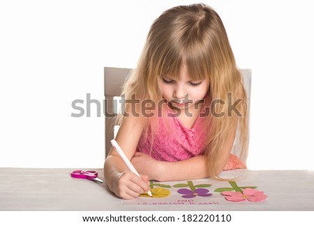 Little girl making a crafts. - stock photo