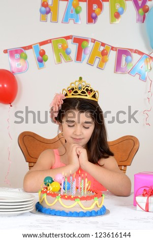 Little girl making birthday wish
