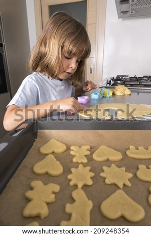 Little girl making cookie dough at home - stock photo