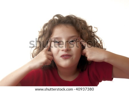 little girl making funny face - stock photo